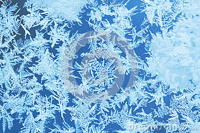 Winter ice frost, frozen background. frosted window glass texture. Cold cool icicles background. Winter wonderland scene.