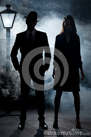 Film noir gangster couple street light mist
