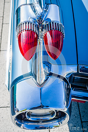Detail of the rear wing and brake lights of the car Cadillac Coupe de Ville, 1959.