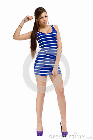 Young casual fashion beautiful girl standing in  studio