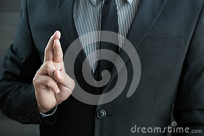 Dishonesty, Business fraud concept, Businessman showing fingers