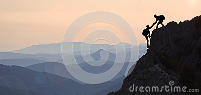 stock image of help mountaineering & peak performance