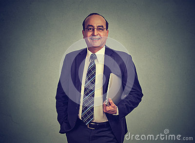 Businessman holding laptop computer in his hand