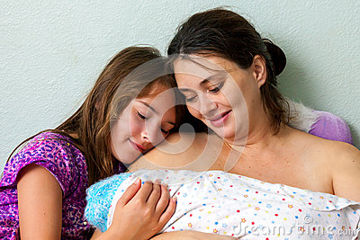 Mother And Daughter Adore Newborn