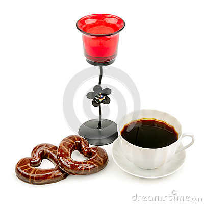 Cup with coffee, biscuits and a candlestick