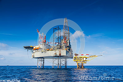 Oil and gas drilling rig work over remote wellhead platform to completion oil and gas produce well