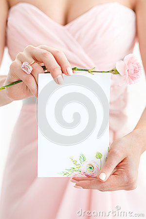 Wedding polygraphy. Invitation in the hands of women.