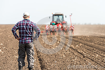 Young farmer on farmland
