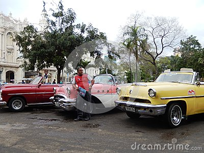 TAXI DRIVER AND VINTAGE AMERICAN CARS, HAVANA, CUBA