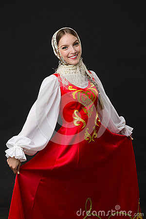 Beautiful smiling caucasian girl in russian folk costume