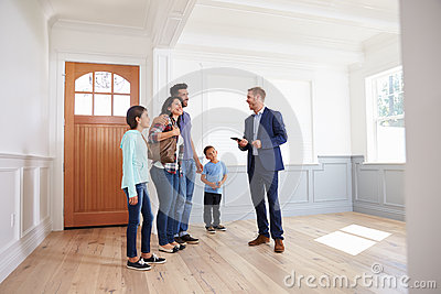 Realtor Showing Hispanic Family Around New Home