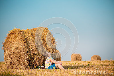 Beautiful Plus Size Young Woman In Shirt Sit Near Hay Bales In S