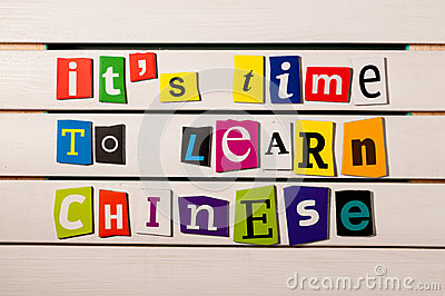 It's time to learn chinese - written with color magazine letter clippings on wooden board. Chinese language learning