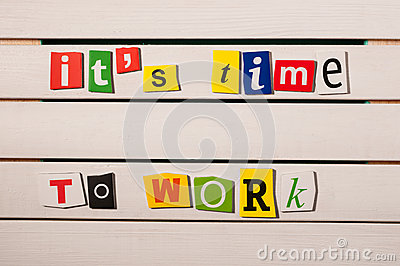It's time to work - written with color magazine letter clippings on wooden board. Concept  image