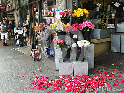 Clarinet player outside a flower shop near Pike Place Market, Seattle