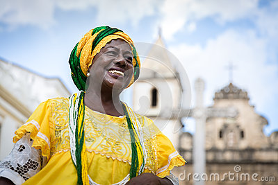 Brazilian woman of African descent wearing traditional clothes from the state of Bahia in the old colonial district of Salvador