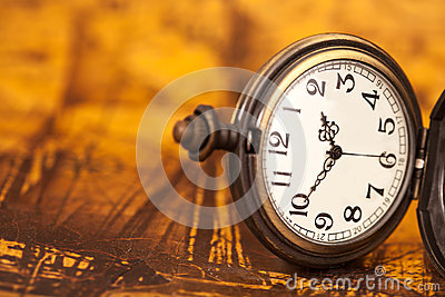 Pocket watch on old map background,