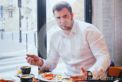 Displeased angry unhappy customer in restaurant
