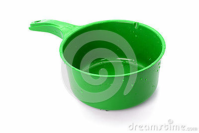 Green plastic bowl with water drop isolated on white background