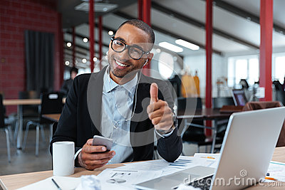 Stylish young businessman showing okay sign