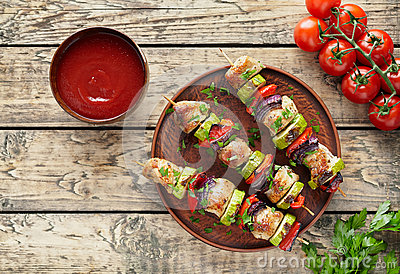 Barbecued turkey or chicken meat shish kebab skewers with ketchup