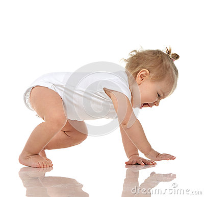 Infant child baby girl in diaper crawling happy laughing smiling