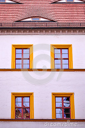 Facade with four orange framed windows
