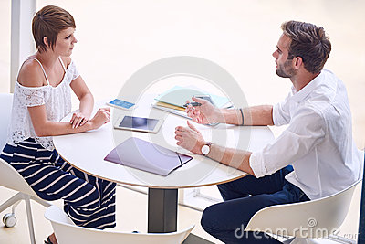 Professional consultant giving business advise to aspirational businesswoman
