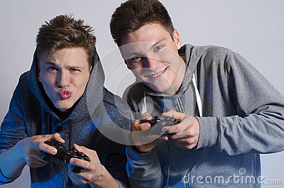 Two friends making funny faces while playing video games
