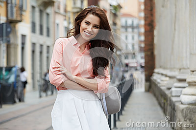 Pretty trendy girl posing at the city in Europe,