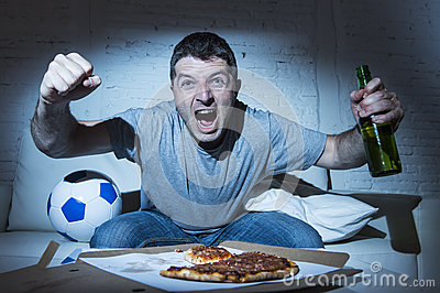 Fanatic crazy football fan watching television soccer screaming happy celebrating scoring goal