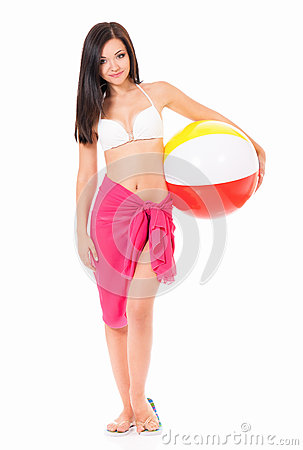 Woman in swimsuit with beach ball