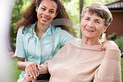 Afroamerican carer and ill patient