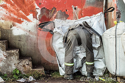 The man looking through rubbish
