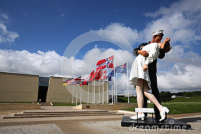 25 foot tall Unconditional Surrender statue dwarfs the Caen Memorial building in Normandy, France