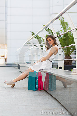 Beautiful woman shopping in the summer city