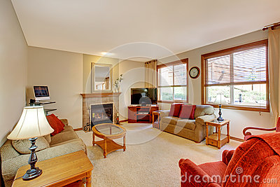 House interior. Peach and red living room with fireplace and red furniture.
