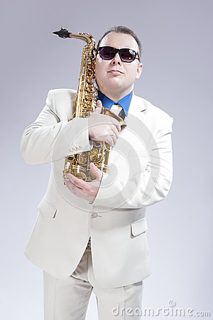 Male Saxophone Player Posing With Alto Saxo In White Suit and Sunglasses