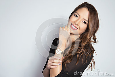 Portrait of beautiful young asian womanbeautiful young asian woman wearing a wrist wat