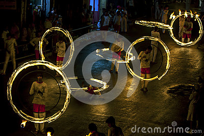 A spectacular site as Fire Ball Dancers perform along Colombo Street in Kandy during the Esala Perahera in Sri Lanka.
