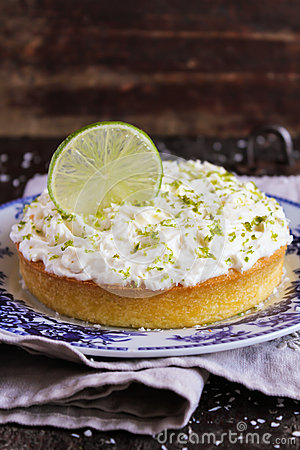 Pound cake with lemon, lime and freshly shredded coconut with cream cheese frosting