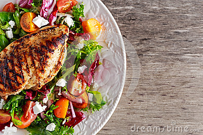 Grilled Chicken Breast fillet with fresh tomatoes vegetables salad. concept healthy food.