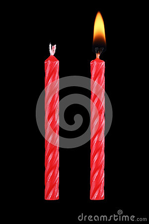 two red birthday candles isolated on black