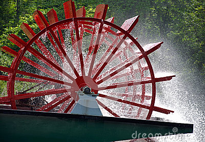 Red paddle wheel on river boat