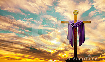 Christian cross over bright sunset background