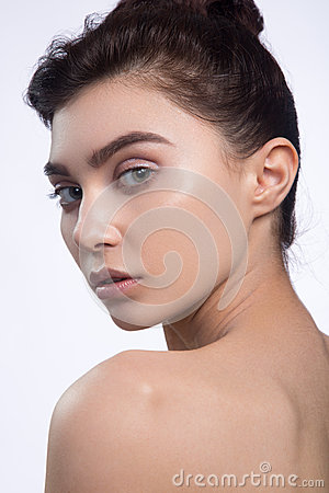 Beautiful Face of Young Woman with Clean Fresh Skin close up isolated on white. Beauty Portrait. Beautiful Spa Woman