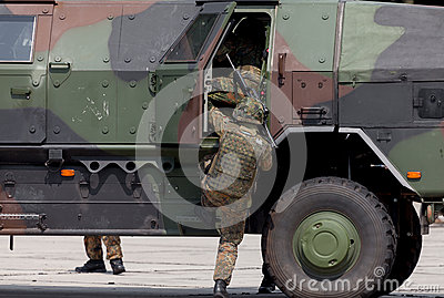 German soldier get into an armoured vehicle