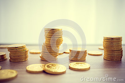 Golden coins concept on a wood table.Taxpayer business concept