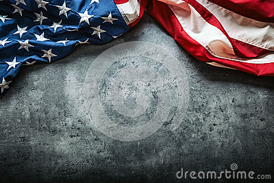 USA flag. American flag. American flag freely lying on concrete background. Close-up Studio shot. Toned Photo
