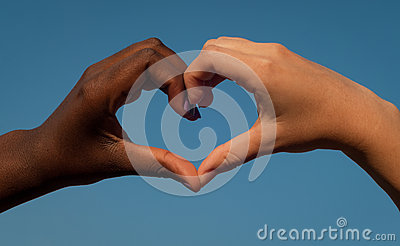 Black and white hands in heart shape, interracial friendship concept